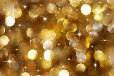 golden glow: Christmas high contrast golden lights background with little stars Stock Photo