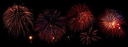 Composition of fireworks over black background photo