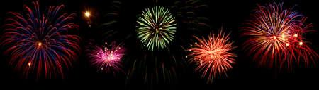 Line of fireworks over black background