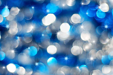 Christmas silver and blue lights background with little stars