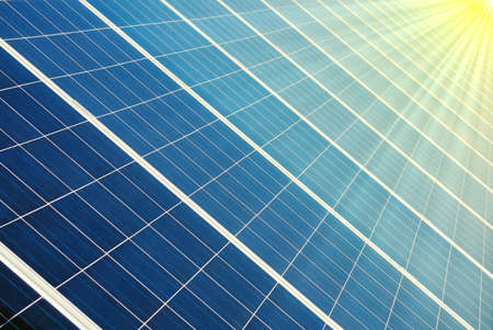 Photovoltaic cells of a solar panel with illuminated by sun Stock Photo