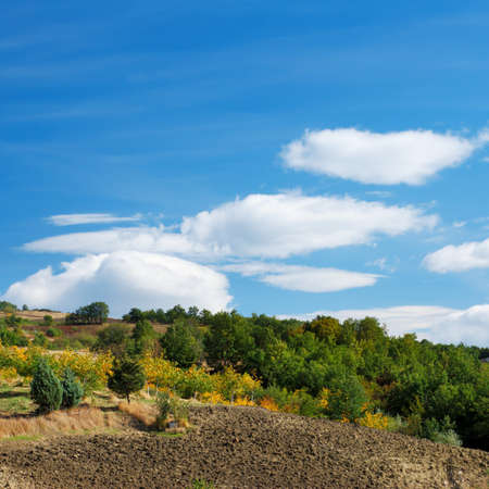 Plowed fields and moody blue and white sky in Molise (Center Italy) Stock Photo