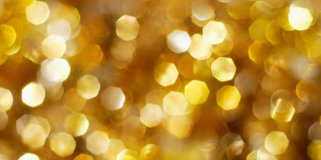 Bright golden Christmas lights background photo