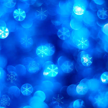 Abstract cold blue night background with snow flakes photo
