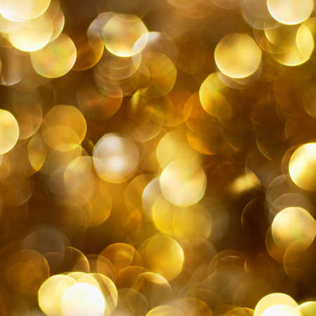 Dark golden defocused Christmas lights background Stock Photo - 8140489