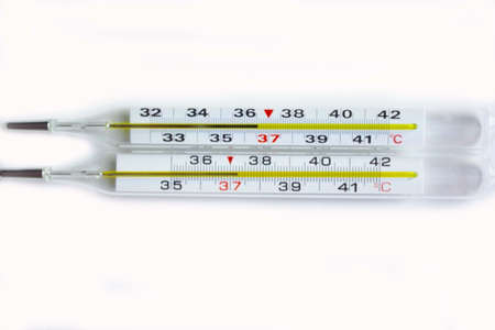 mercury thermometer for measuring temperature on a white background