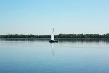 lonely sailboat floats on the river Russia