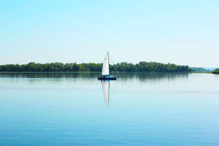 yacht sailing on the river in sunny weather Volga rk landscape Russia