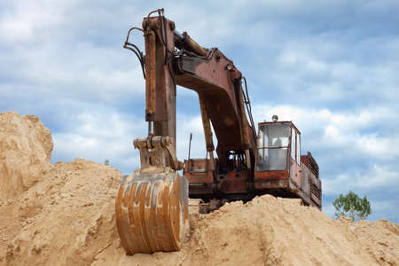 stormed: Dredge on a heap of sand