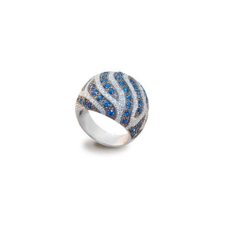 golden ring with diamonds and sapphires on a white photo