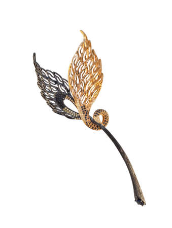 jewell: golden brooch with black and yellow diamonds on a white, black and yellow gold Stock Photo