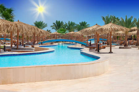hurghada: HURGHADA, EGYPT - APR 29, 2012: swimming pool at Hilton Long Beach Resort Hotel in Hurghada, Egypt Editorial