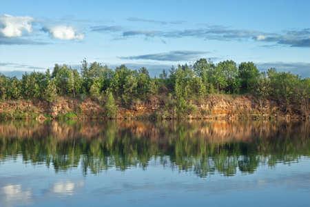 reverberation: Lake in wood open-cast mine