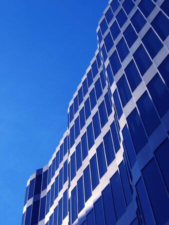 modern building in barcelona. Glass against blue sky with space for text. Stock Photo
