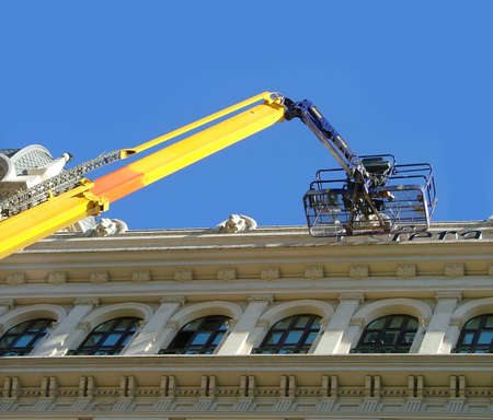 working in the street with a yellow crane