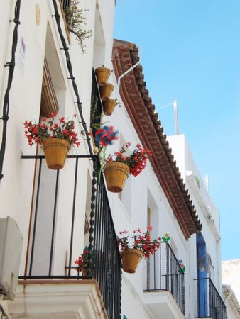 traditional architecture, detail of a terrace with a windy object. Stock Photo
