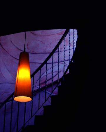 stairs and lamp with a very warm and calid light
