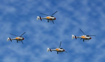 helicopters surfing clear sky. Space for text