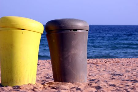 recycle: two boxes in the beach