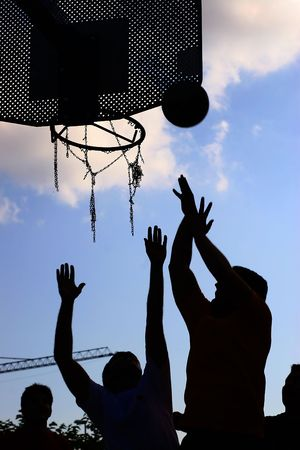 silhouette of a team playing basket