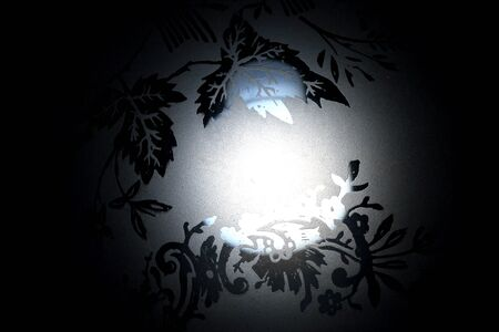 detail of a lamp with black background