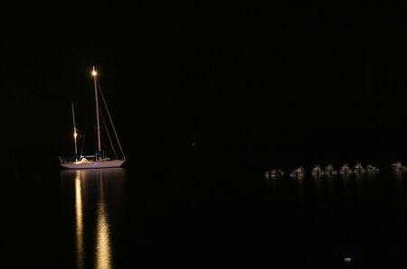 night image of an illuminated yacht