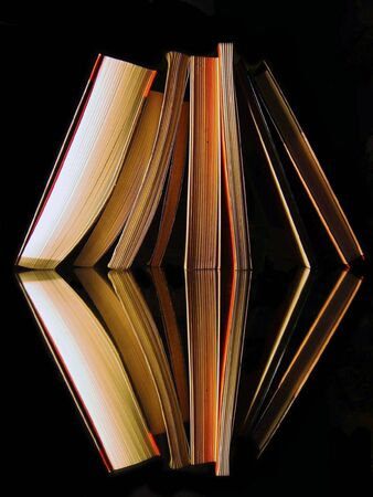 books are reflected in a mirror Stock Photo