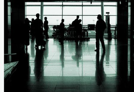 people silhouettes walking in an airport Stock Photo