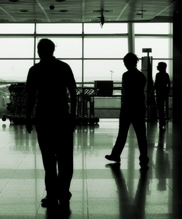 people silhouettes walking in an airport Stock Photo - 1858710