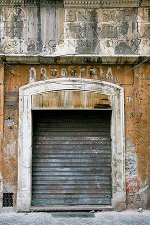 old business in the ghetto neighbourhood in Roma. Wall is dirty and broken Stock Photo
