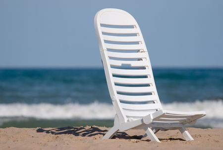 beach at daytime with chairs and umbrella.