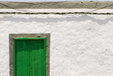 green door on textured wall Stock Photo