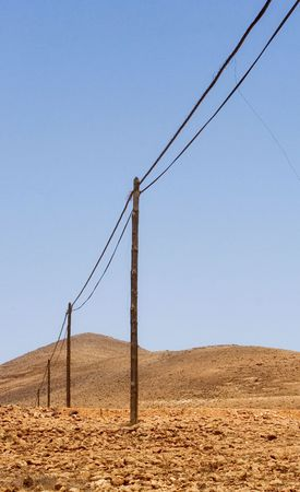 old telephone poles and wires in intense colors. Vertical image photo