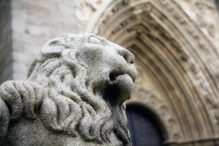 Close-up of the lion sculpture in front of the Cathedral of Avila, Spain. Stock Photo