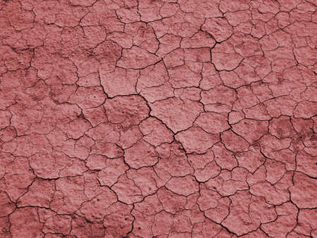 Background image of dry, cracked earth representing droughtglobal warming photo