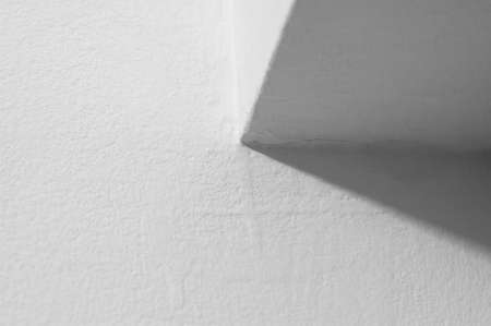 White abstract photo of an architectural corner with room for your text