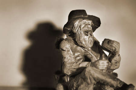 Sepia image of an old man figurine photo