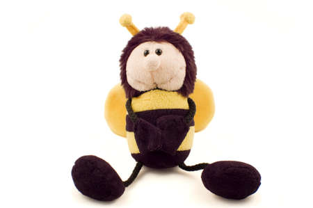 Plush bumble bee soft toy in a sitting pose isolated on white.