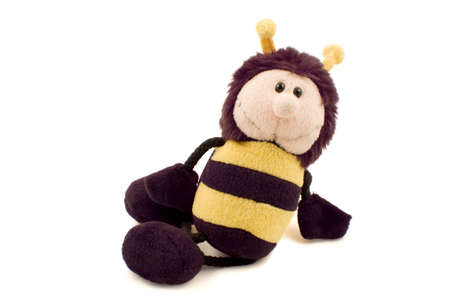 Plush bumble bee soft toy in a relaxing pose isolated on white.
