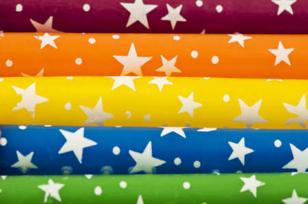 Colorful rainbow candles with sparkling stars in horizontal lines.