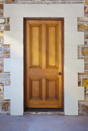 Image if a wooden entrance door in an old colonial building.