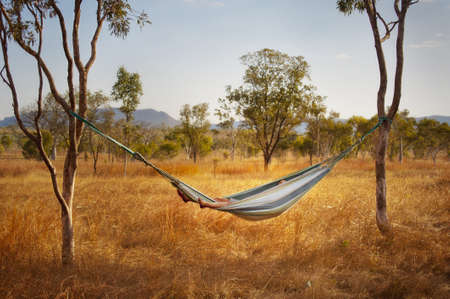 Relaxing in a hammock in the Australian outback  Stock Photo
