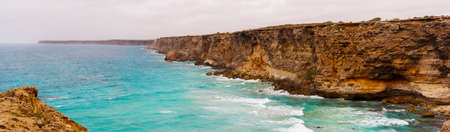 Panoramic view of large cliffs along the coastline  Stock Photo