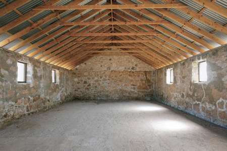 The interior of an empty stone building