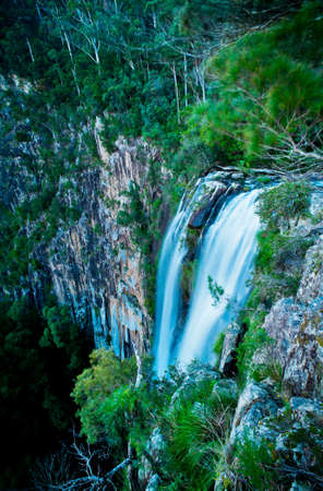 cliff edge: A waterfall plummets off a high cliff edge  Stock Photo