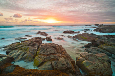A rough and rocky coastline at sunset