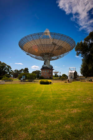 Satellite dish pointed towards the sky on a sunny day. Stock Photo