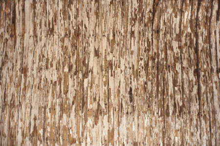 Background image of a peeling and cracked painted wood texture. Stock Photo