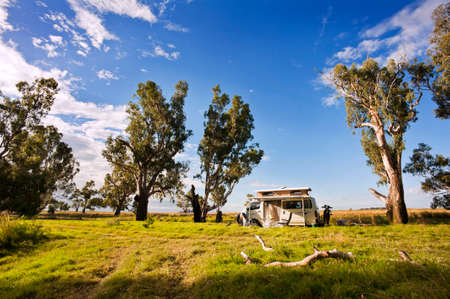 A motorhome is set up, ready for camping in a quiet, secluded part of the Australian bush. Stock Photo