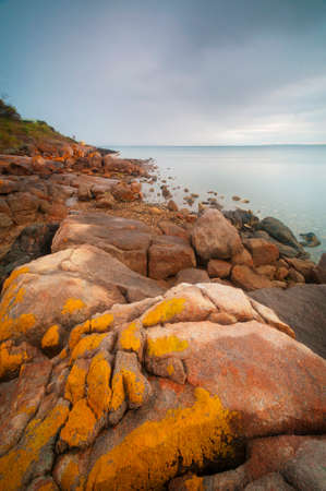 rugged: Exploring the rocks of a very rocky, rugged coastline.